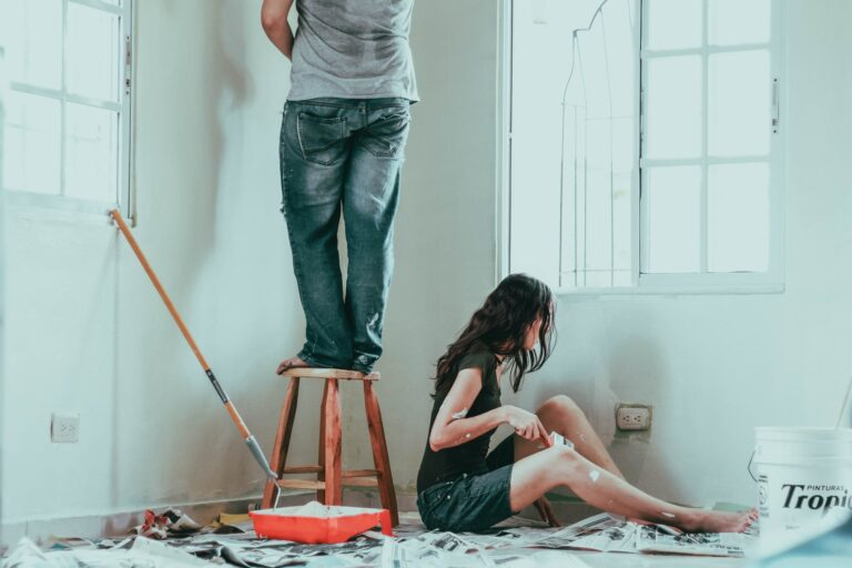 Couple painting their house